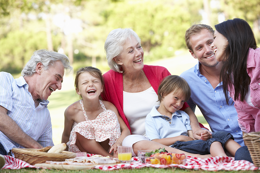 multi-generational family enjoying a picnic