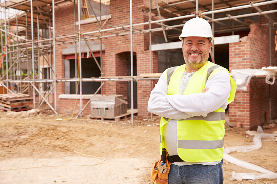 image of a construction worker at a commercial property under construction