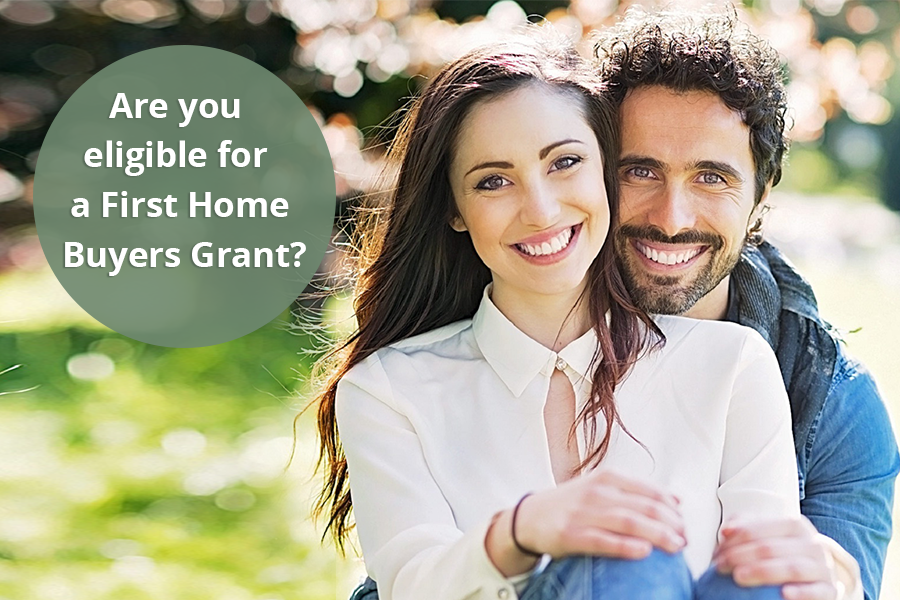 happy couple with a text bubble reading are you eligible for a first home buyers grant?