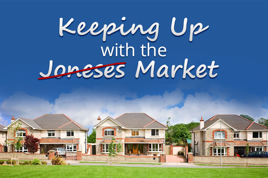 Photo of some houses at a distance with text reading keeping up with the Joneses (crossed out) Market