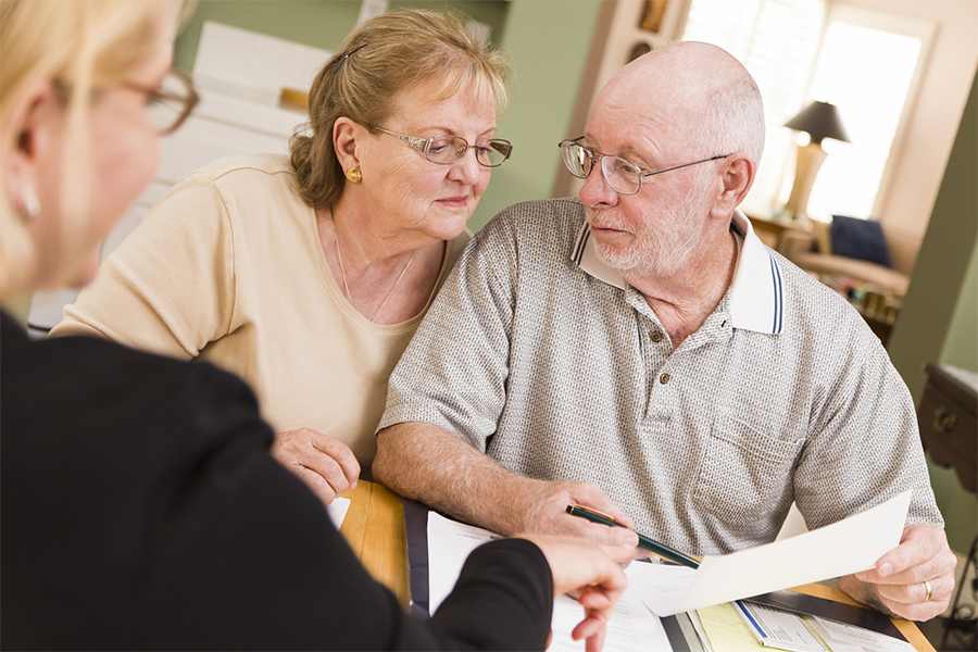 senior couple speaking with a lawyer to plan for the future