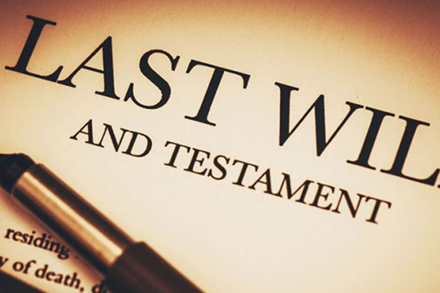 close up of a last will and testament with pen