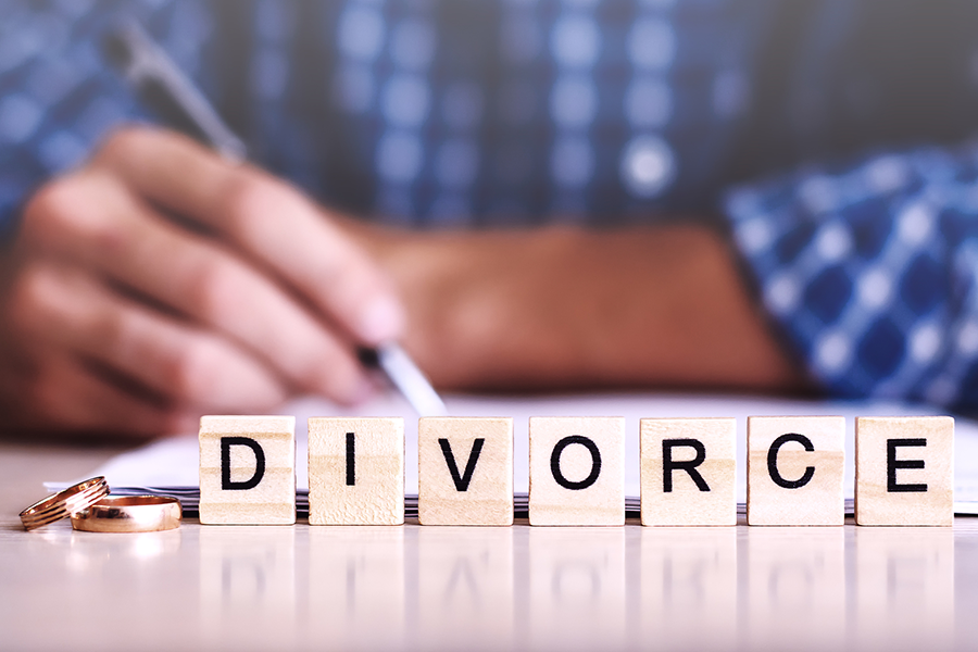 divorce lettering spelled out in wooden tiles
